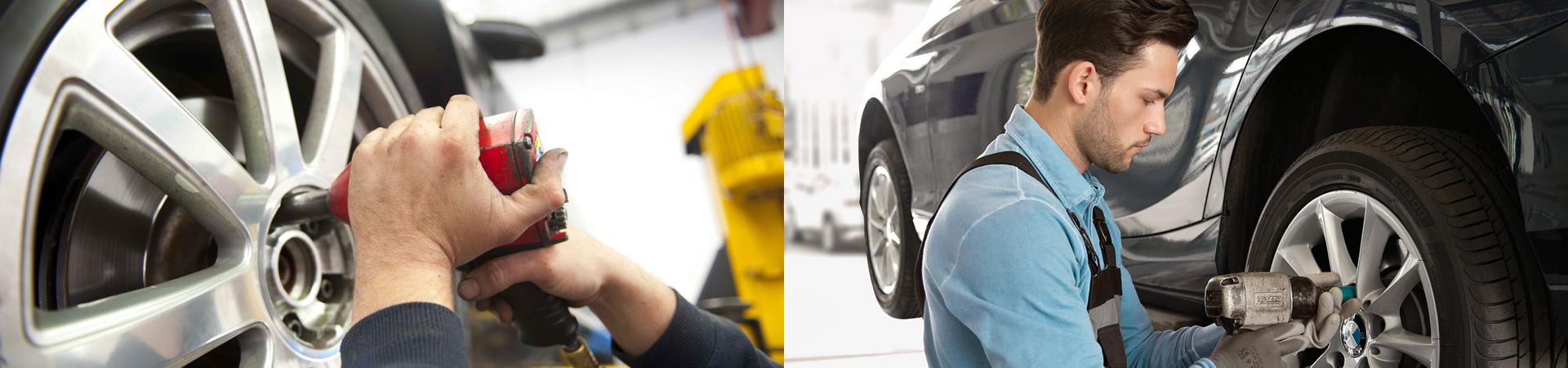 Foto di tecnico che sostituisce un pneumatico
